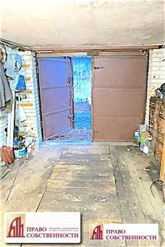 Продается кирпичный гараж со