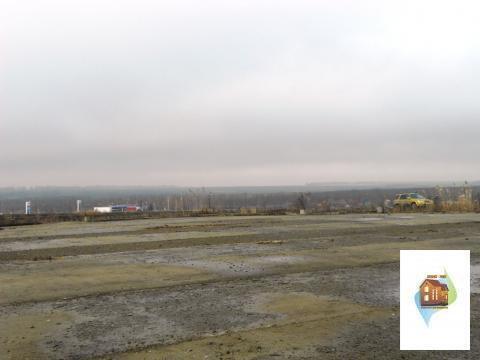 Участок вдоль трассы Таганрог-Ростов под строительство в г.Ростов - Фото 1