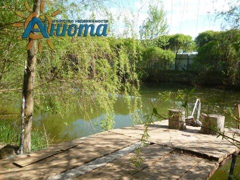 Участок с прудом в деревне Жуковского района Грачевка. - Фото 1