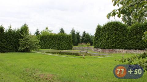 Дом и земельный участок в коттеджном