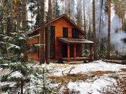 Загородный новый дом в лесу на берегу Волги