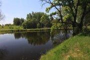 Участок на берегу пруда - Фото 1