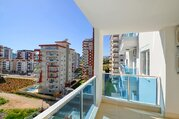 Квартира в Махмутларе, Купить квартиру в новостройке от застройщика Аланья, Турция, ID объекта - 323098093 - Фото 18