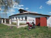 Двухкомнатный бревенчатый дом с гаражом в пос. Петровский - Фото 1