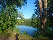 Участок с панорамный видом, расположенный на берегу большого озера - Фото 4