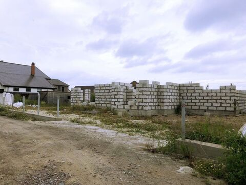 Земельный участок в д. Узигонты 10.55 соток ИЖС с фундаментом, . - Фото 1