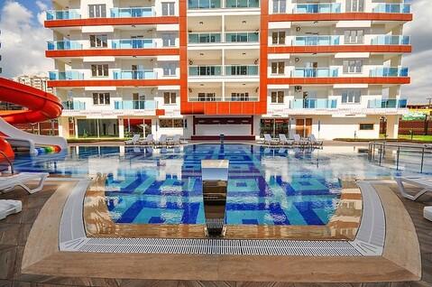 Квартира в Махмутларе, Купить квартиру в новостройке от застройщика Аланья, Турция, ID объекта - 323098093 - Фото 1
