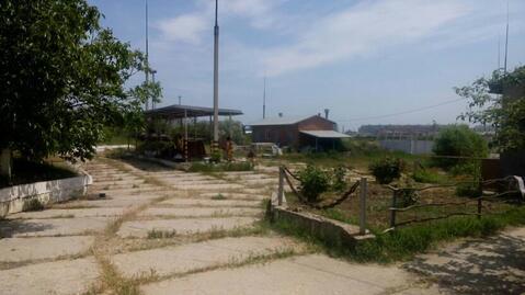 Промышленная площадка с ангаром в Крыму. - Фото 1