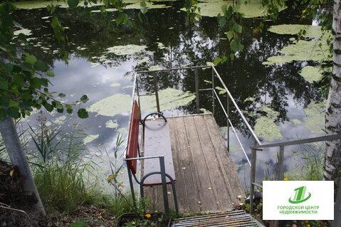Кирпичная дача с индивидуальным спуском к озеру - Фото 1