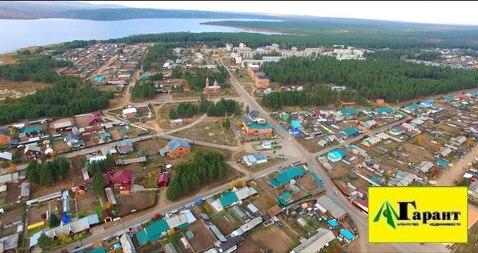 Продается земельный участок 55 сот. в Иркутсой обл. пгт. Новая Игирм - Фото 1