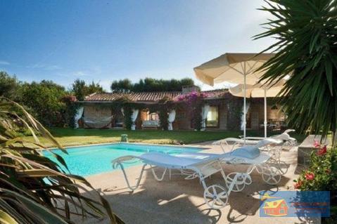 Вилла класса люкс с бассейном в аренду на Сардинии. - Фото 1