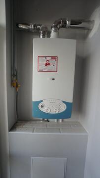 Купить двухкомнатную квартиру с ремонтом, автономное отопление, центр. - Фото 4