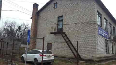 Продажа двух этажного здания с магазином и гаражами - Фото 4