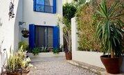 Отдельная трехкомнатная квартира с большим садом в районе Пафоса