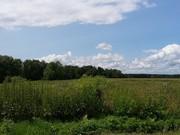 Земельный участок площадью 20 соток в жилой деревне.