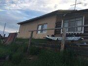 Дом на берегу реки Лена