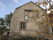 Продажа земельного участка в Симферополе с недостроем.