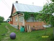 Продается дом в д. Трубино на берегу реки, 40 соток. - Фото 1