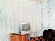 Продажа комнаты в пятикомнатной квартире на улице Калинина, 110а в .